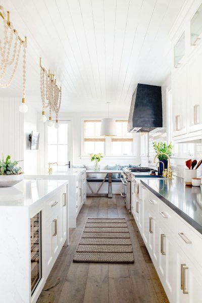 white kitchen with pendant lights